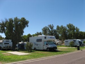 Shady grassed caravan and camping sites at Arno Bay